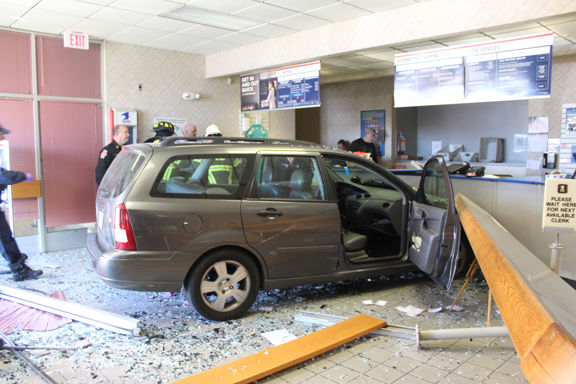 4 hurt when car crashes into post office service area | Local News