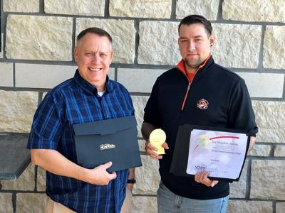 Members of advancement department bring home awards