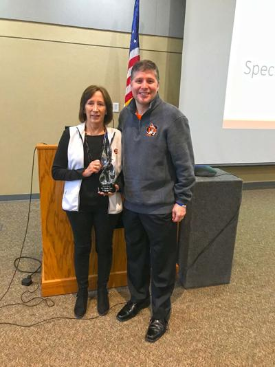 Cowley hands out awards at in-service