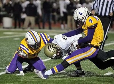Blatchford and Bucher with the tackle
