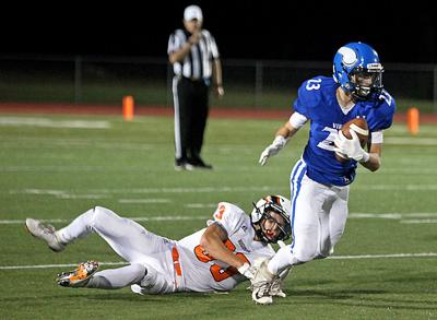 Trent Beckwith breaks a tackle