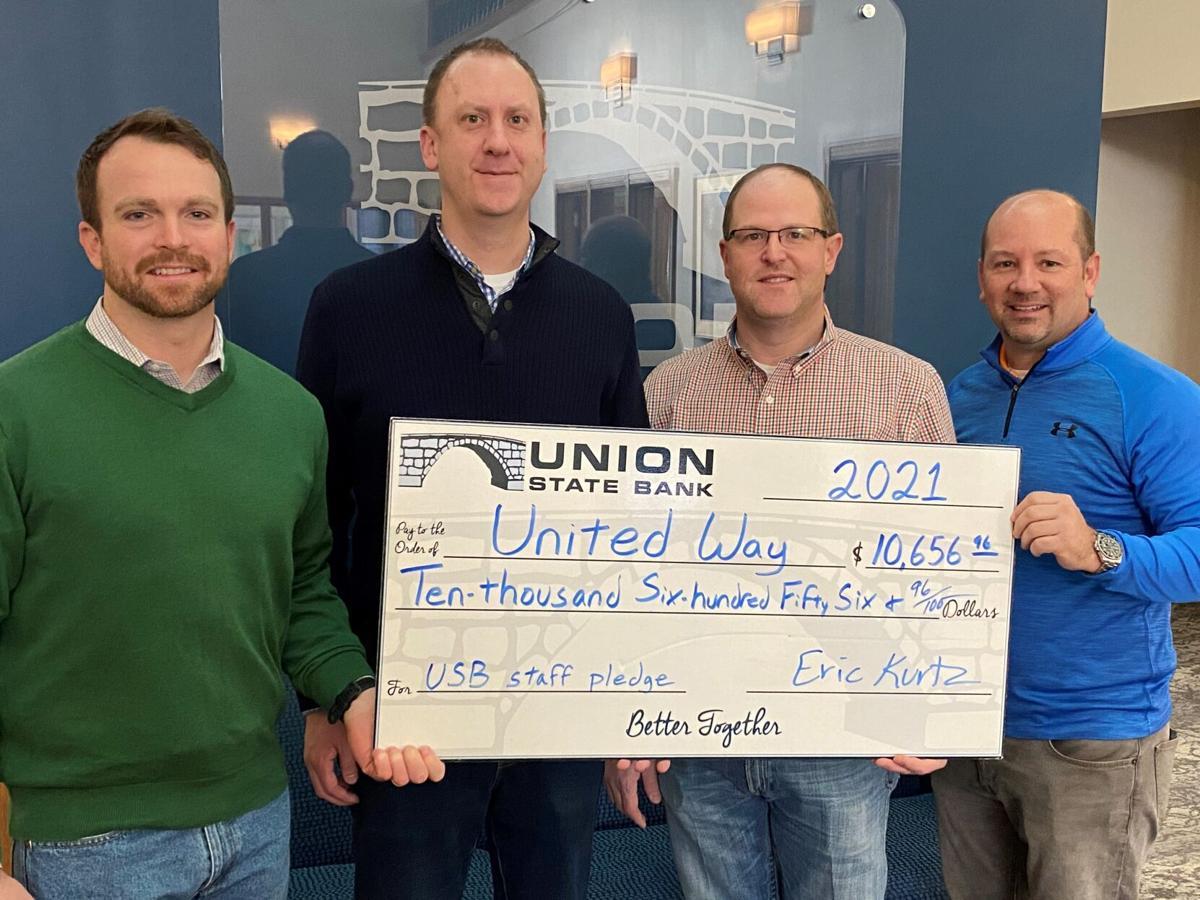 USB staff pledge $10K to United Way