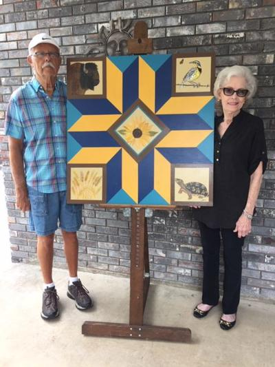 Local artists gift Kansas-themed barn quilt to Historical Society