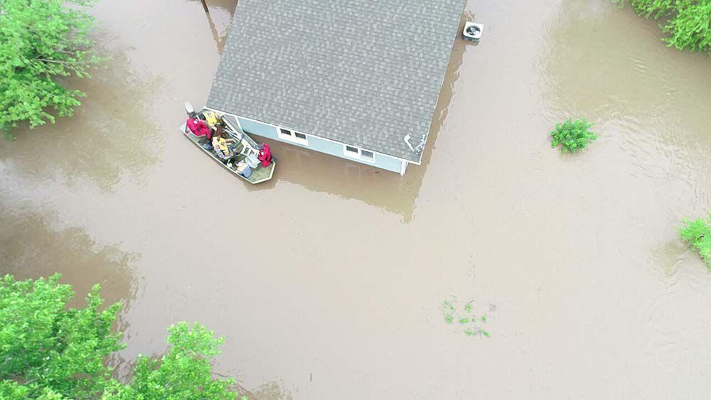 Family rebuilds after flood