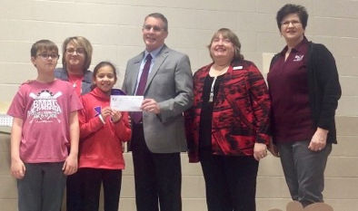 Lowell Elementary receives donation from RCB Bank