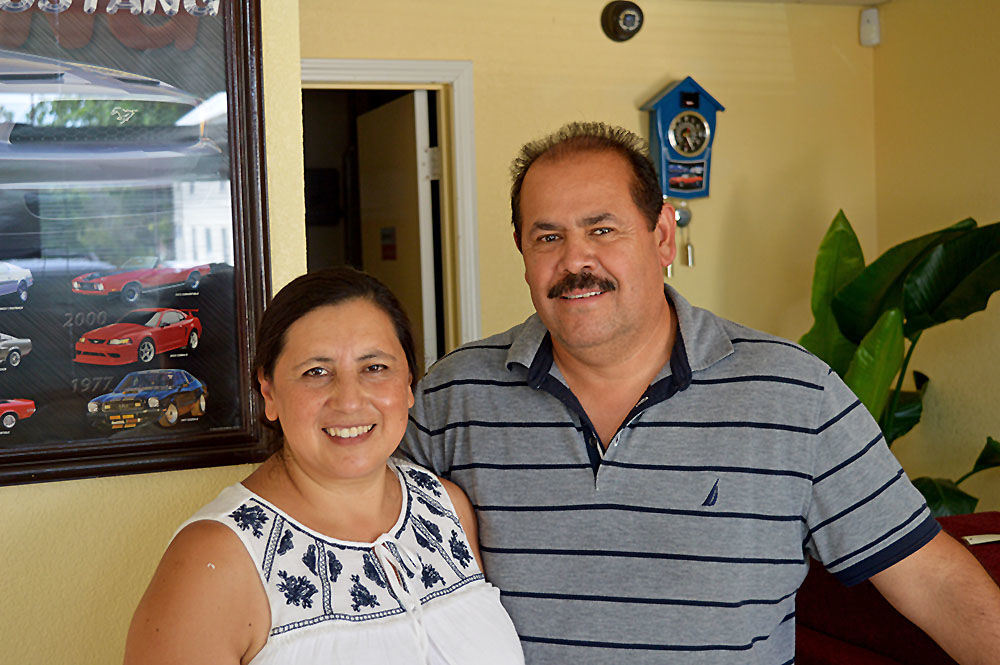 Couple opens new car lot