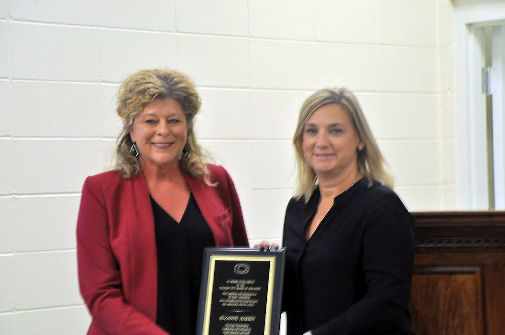 Patterson presents Harbin with plaque
