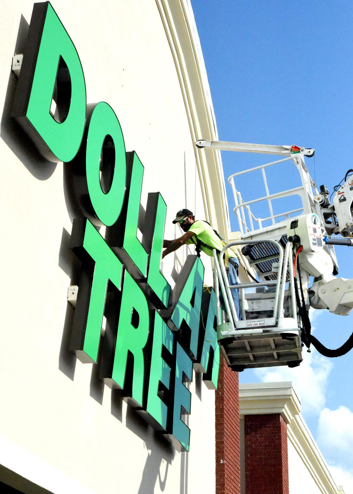 Brandon Criddle With Advance Sign Lighting Company LLC Installs A New Dollar Tree Monday Afternoon At Marketplatz Center In Southwest Cullman