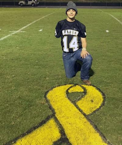Jadon Neely gets support from Hayden High classmates