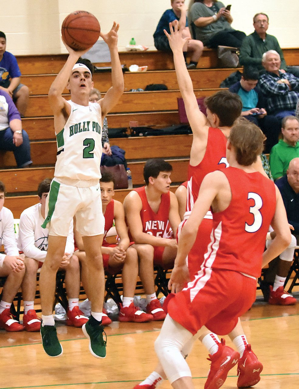 df3a1cabe8d Holly Pond s Isaac Ludwig knocks down a 3-pointer during the first half of  Thursday s game.