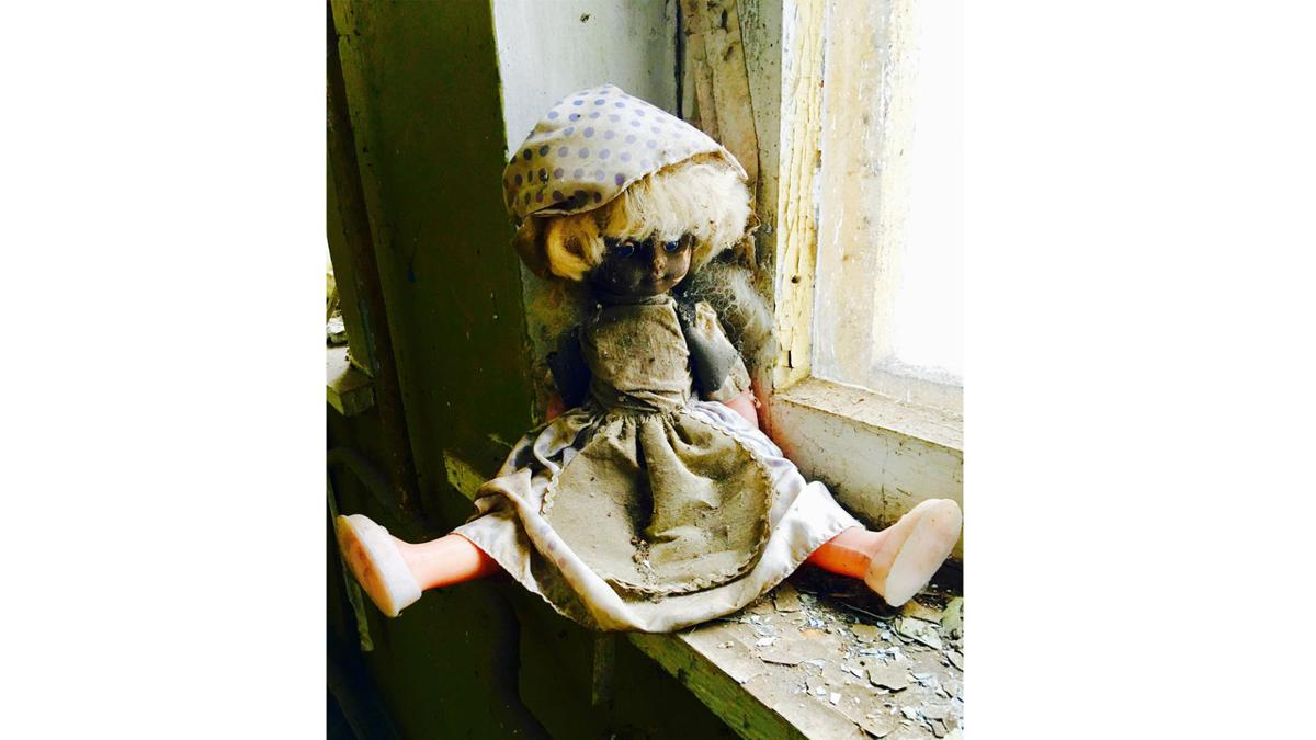 A doll left in the remains of an orphanage in an abandoned village in the Chernobyl Exclusion Zone.