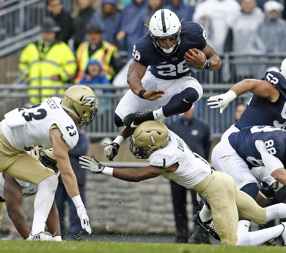 Barkley dazzles in Penn State's 52-0 win over Akron
