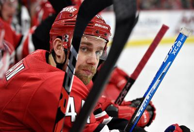 Calvin de Haan #44 of the Carolina Hurricanes watches his team play against the Pittsburgh Penguins during their game at PNC Arena on Dec. 22, 2018 in Raleigh, N.C.