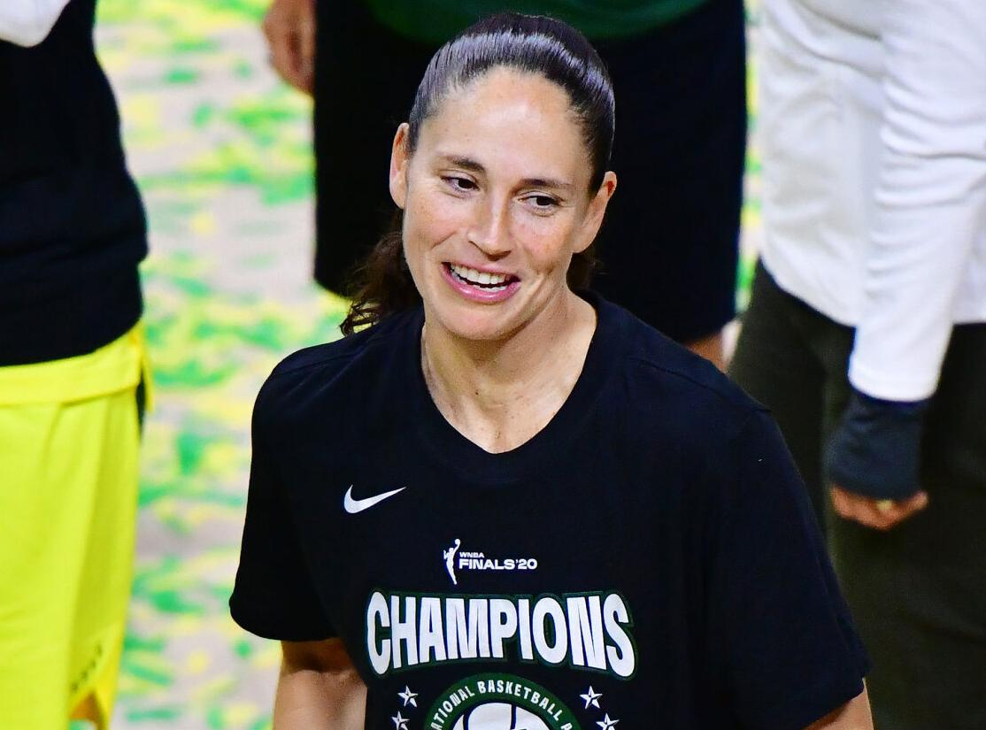 Sue Bird of the Seattle Storm looks on while holding on to the WNBA Championship trophy after defeating the Las Vegas Aces during Game 3 of the WNBA Finals at Feld Entertainment Center on October 6, 2020, in Palmetto, Florida.