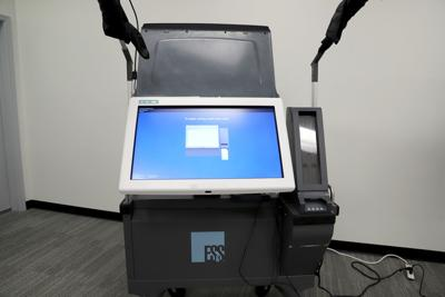 Voting machines bill vetoed in fight over election changes