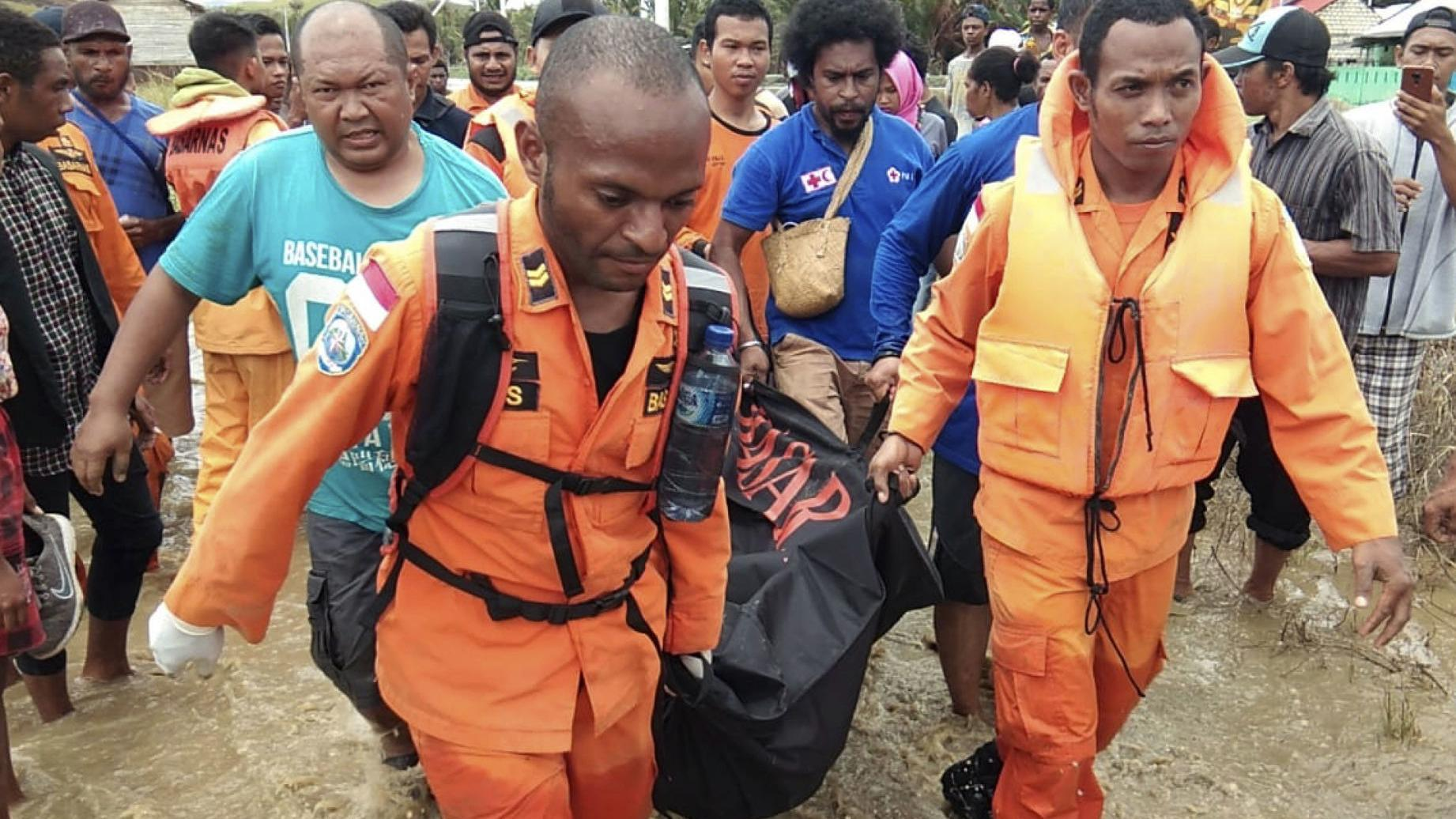 Flash floods, earthquake kill more than 80 in disaster-prone Indonesia