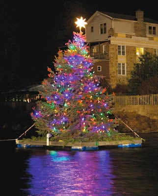 The floating Christmas tree at Children's Lake in Boiling Springs was lit  during a ceremony Sunday evening. - Boiling Springs Holds Tree-lighting Ceremony The Sentinel: News