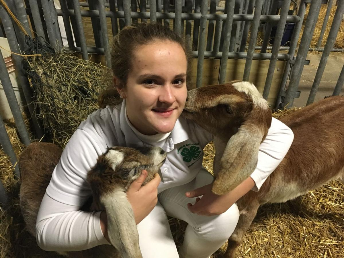 Abby Beidel with goats