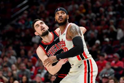 Carmelo Anthony (00) of the Portland Trail Blazers and Tomas Satoransky (31) of the Chicago Bulls battle for a rebound during the second half on Nov. 29, 2019 at the Moda Center in Portland, Ore.