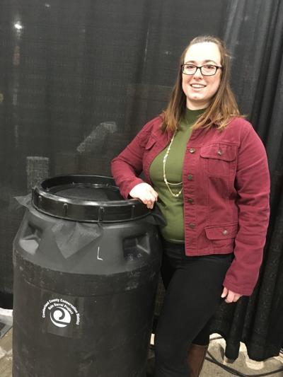 Lori Glace with rain barrel