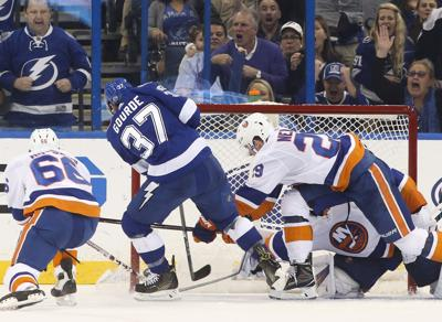 The Tampa Bay Lightning's Yanni Gourde (37) puts a shot past New York Islanders goalie Thomas Greiss (1) at the Amalie Arena in Tampa, Fla., on December 5, 2017.