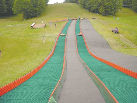 Ski resorts starting offering new dry summer tube slopes activity on slopes