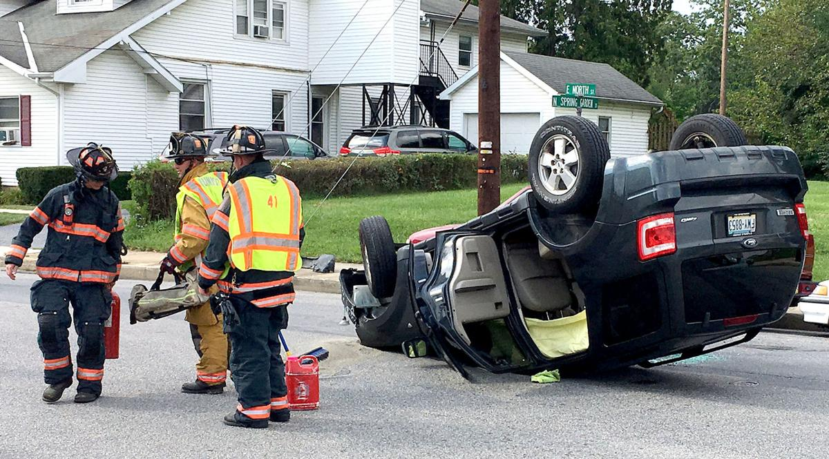 Car Overturns At Intersection Of North Spring Garden Streets In