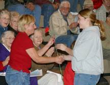 Mary Ann Harwood is just one of several veterans that were recognized and presented a carnation in appreciation of their efforts in the fight for our country's freedom during the Veterans Day Assembly held at Shelby High School. photo by Cynthia Gillund