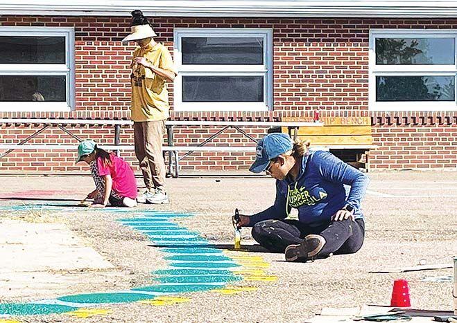 Valier teachers, volunteers undertake playground improvement project