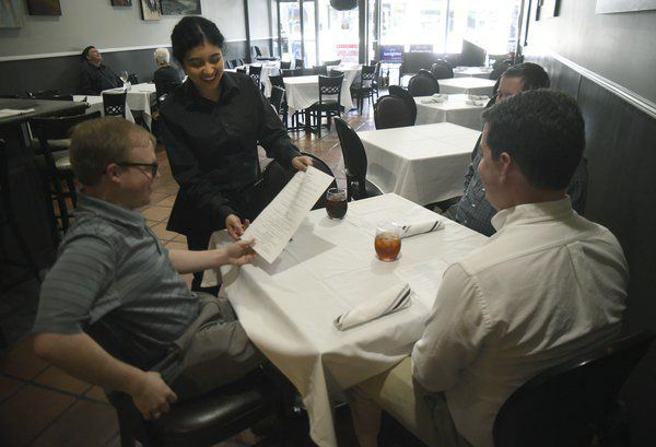 Restaurants move to delivery, curbside pickup to woo virus-wary customers
