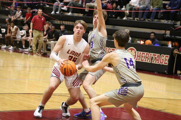 High school basketball roundup: Southeast's Rich gives Raiders win at the buzzer; Creek girls, Christian Heritage boys get wins