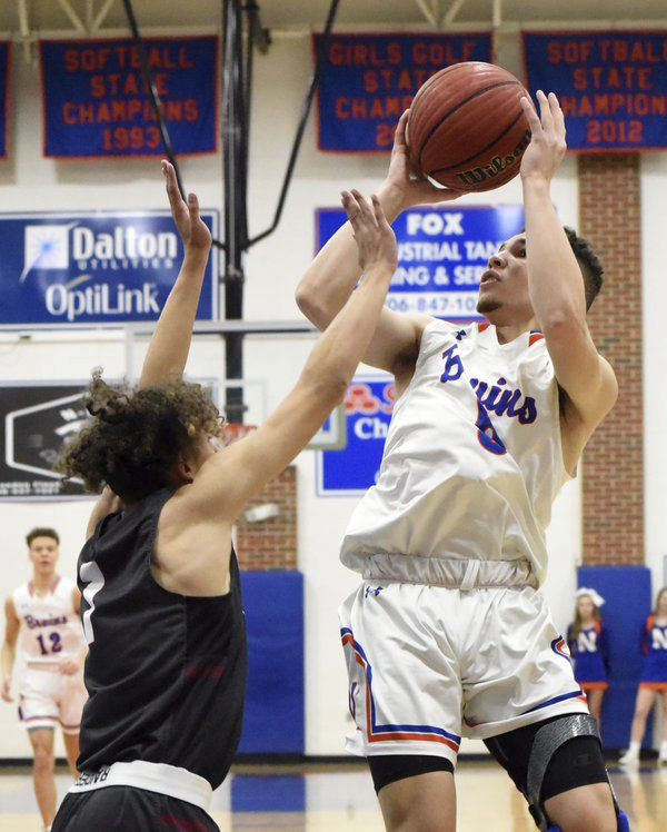 Northwest boys, girls beat county rival Southeast