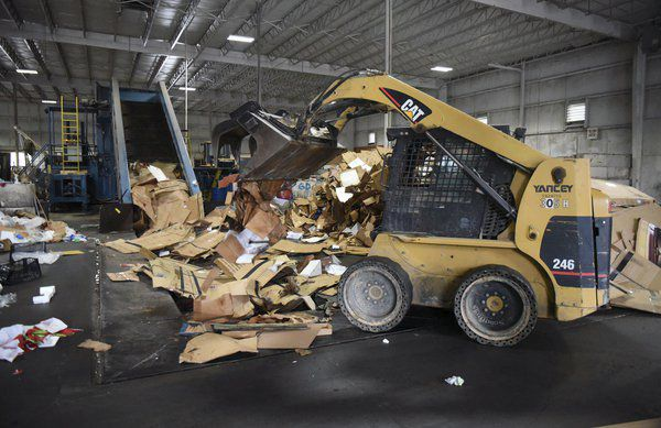 Trash piles, money pits: Communities weigh recycling cost in disrupted market