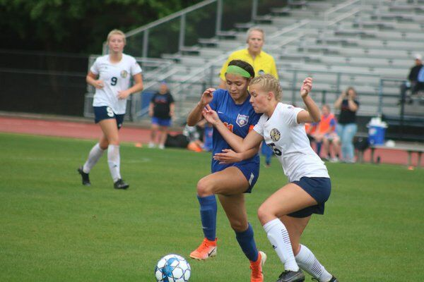 Downpour for the Final Four: Northwest girls brave rain for a 4-0 win, program's first trip to state semis