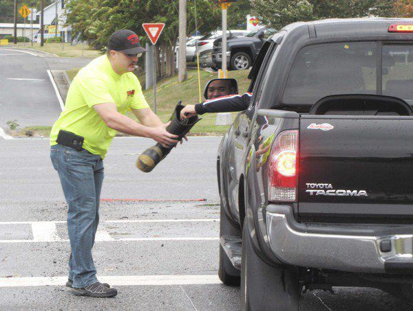 Generous motorists help Whitfield firefighters, Dalton Shriners with boot drive