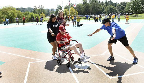 Businesses step up to repair, beautify Miracle Field ball