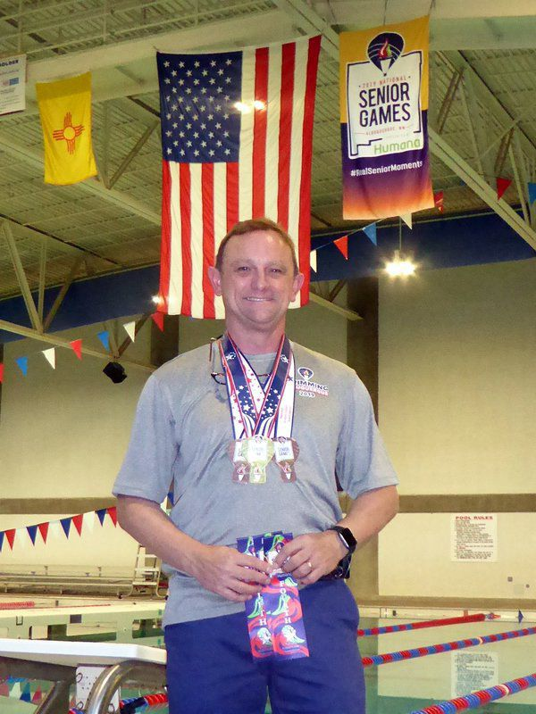 Still swimming: Nearly 40 years since his last competition, local resident wins gold medal at National Senior Games