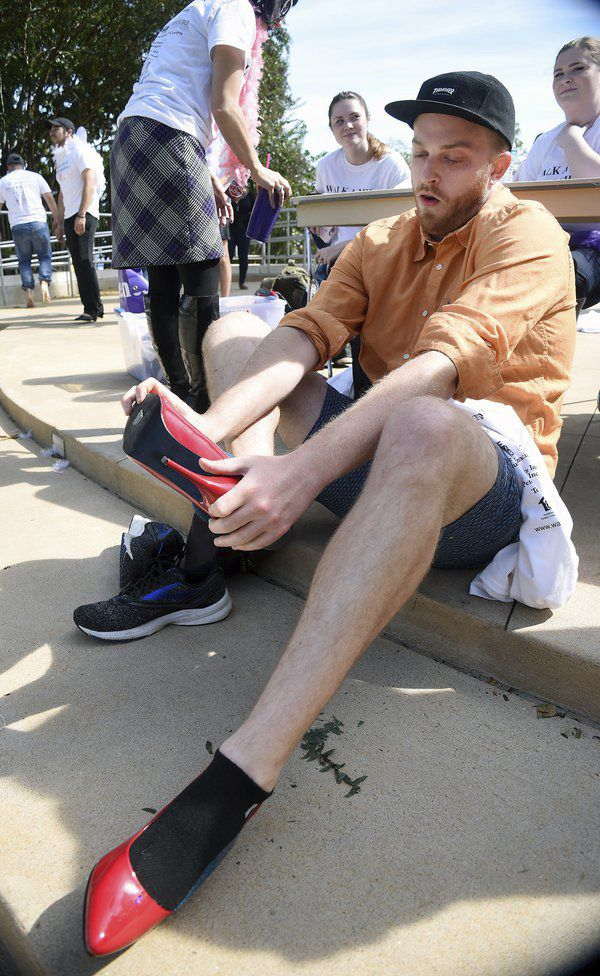 Walk a Mile in Her Shoes participants draw attention to 'a very serious problem'