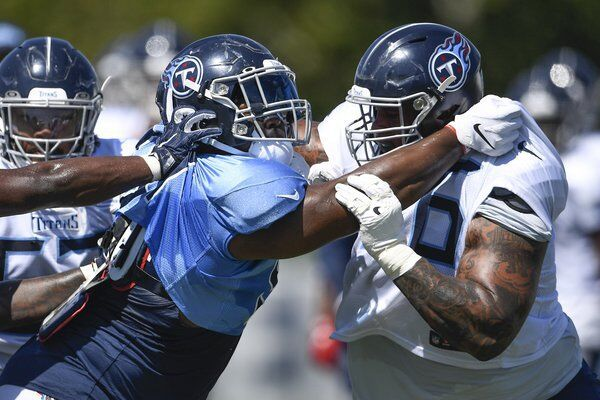 Mack returns to NFL's Titans for second season