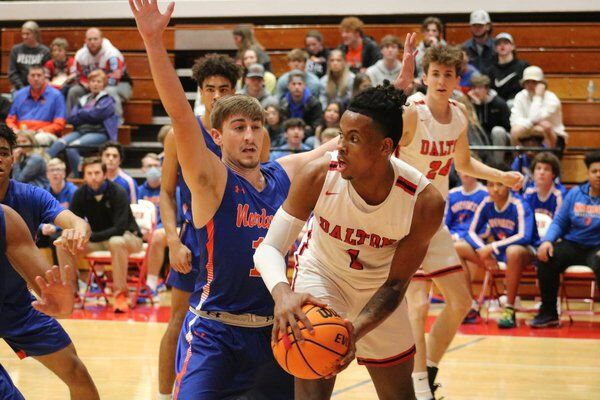 Dalton boys get past Northwest in OT; Lady Bruins hold lead against Lady Cats