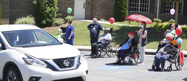 Quinton Memorial holds social distancing parade for residents, family members