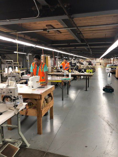 Mohawk partners to create medical gowns; launches project with donation to Hamilton Medical Center