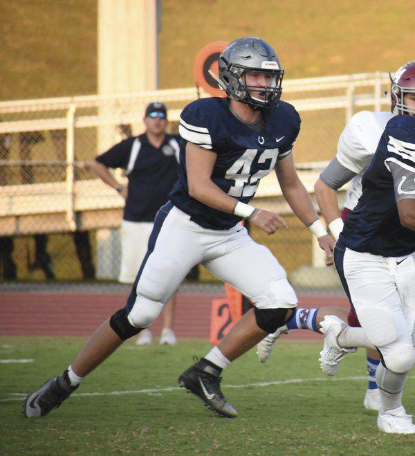 Big swing: Coahulla Creek middle linebacker splits time between football, golf