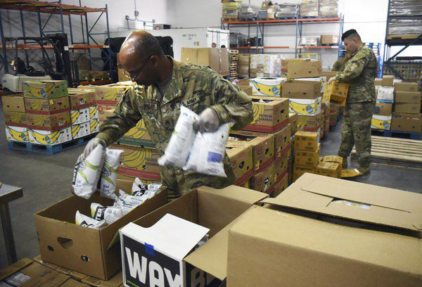 Guarding home and helping the hungry: National Guard assists food bank in Dalton