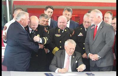 Deal signs firefighter cancer insurance bill, calls it 'a great