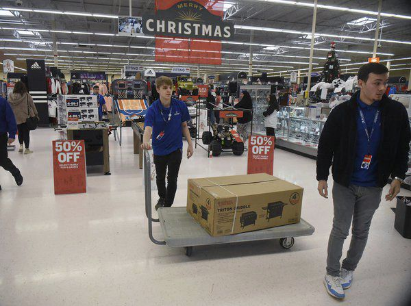 Seeing and touching: Shoppers look for bargains in local stores on Black Friday