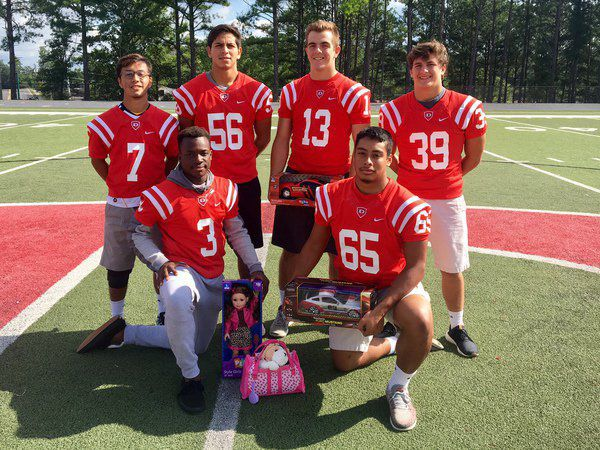 toy drive for christmas program starts at football games - Football Games On Christmas