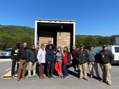 Carpet City Rotary Club distributes food to local families in need