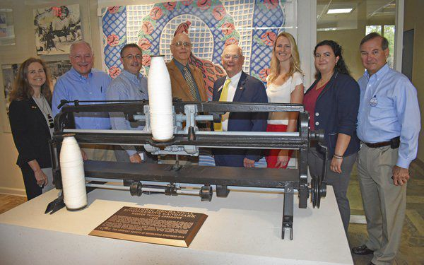 Early tufting apparatus on Shaw Industries' corporate campus in Dalton named a historic mechanical engineering