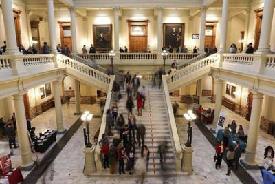 Georgia lawmakers squabble over pay cuts